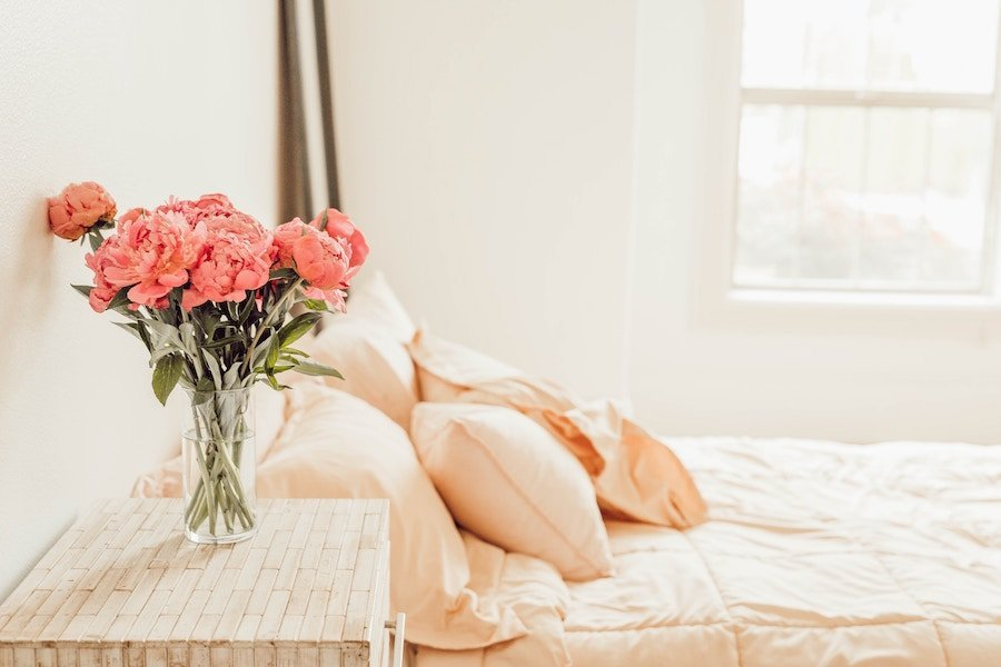 Beautiful smelling hotel bedroom with flowers  Photo by Liana Mikah on Unsplash