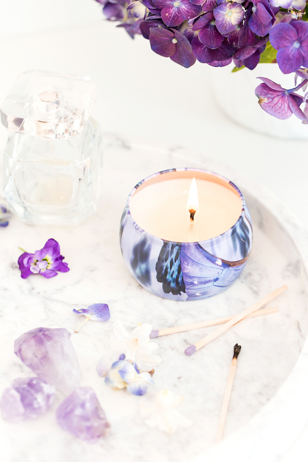Beautiful purple scented candle and flowers
